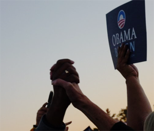 Clasped hands at an Obama rally